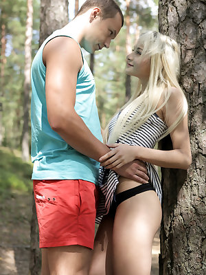 Luscious blonde Olivia Devine is bent on seduction when she leads Joko into the woods while shedding her clothes along the way until she's down to just her thong. Soon they are all alone and able to get it on! Joko finishes the job of getting Olivia naked