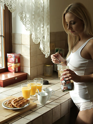 Nathaly is happy to care for her lovers Cayla and Katy Rose by bringing them breakfast in bed. The two girls are still sleeping when Nathaly arrives upstairs, but they wake quickly at her touch. Soon all three girls are naked and caressing each other. Nat