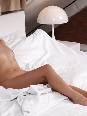 Blonde beauty Violette slips out of her robe to settle into bed for the evening. Since she sleeps in the nude, it is only a matter of moments before her eager fingers have crept up her flat belly to cup around her small perky tits.Laying down on the bed a