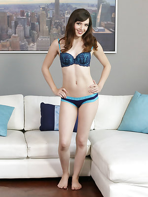 With her slender figure hugged by a matching bra and panties, American student Ember Stone is a delicious feast for the eyes. She'll keep you wanting more as she lets her underwear fall to the floor and then spreads her long legs for a landing strip pussy
