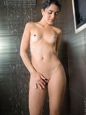 Colombian hottie Danni Ferrer will blow you away with her bikini and wet bod. She steps into the shower before getting naked, letting the warm water seduce her small boobs and full ass before working her fingers in her greedy bare slit to bring herself th