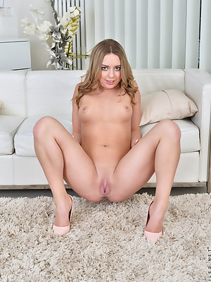 Cute as a button, Daniella Margot dresses in fun flirty clothing that is easy to slip out of whenever the urge hits her. Pulling off her miniskirt dress is a cinch, and peeling off her bra and panties doesn't take much longer. Nude, she contemplates all t