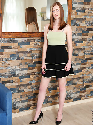 23 year old Linda Sweet is shy and demure, but this tall redhead is hiding a sexy secret beneath her miniskirt. Her landing strip of all natural red hair points the way to her pierced clit, an unexpected bit of naughtiness that lets us know that this swee