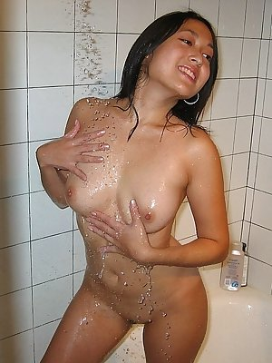 Wet young asian chick taking shower