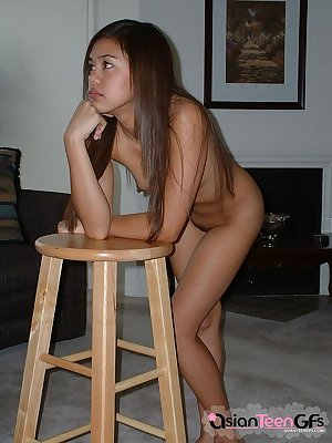 Innocent looking naked asian teen