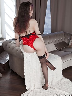 "Ksenia Yankovskaya loves her red lingerie, so she strips it off in an elegant striptease. All naked, she finds a special spot to show us her 5'5"" body. She bends over, shows her hairy bush and is so hot."