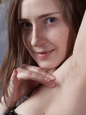 Victoria is 31, and showing off her hairy pits by her green sofa. She takes the dress off and her white panties, and we see her hairy pussy. She touches her bush all over and relaxes on her sofa.