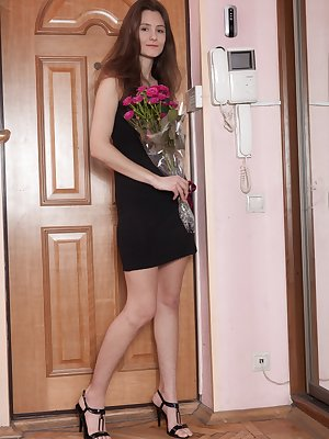 Shivali has received roses and feels extra special. Her black dress and thong comes off and she enjoys the roses across her body. She slides them over her hairy pussy and then she masturbates until done.