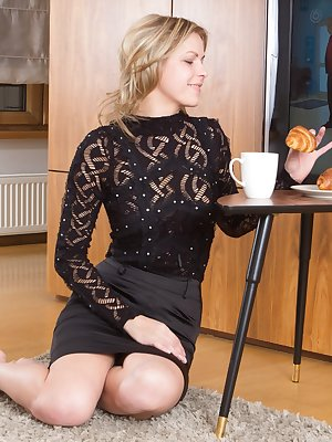 Ayda is enjoying her croissant this morning while in her black dress. She strips naked while eating it, and looks quite sexy. She lays cross the floor naked, showing her hairy bush and enjoying it.