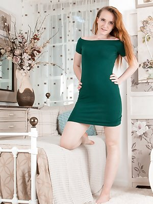 Sabrina Jay is in her room wearing her green dress and pink panties. She takes off the dress and panties, and shows off her 24 year-old figure. She spreads her legs and has a lovely hairy bush to savor.