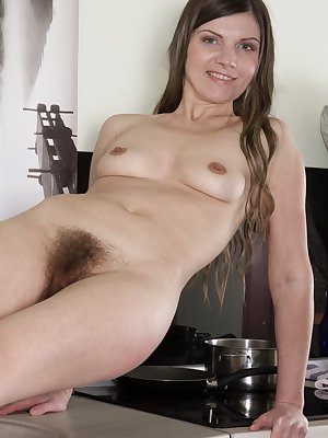 Aga finishes brushing her teeth and strips naked in her bathroom. Her stockings come off and she strips naked for us. She climbs on the counter and has a hairy pussy and sexy body to show.