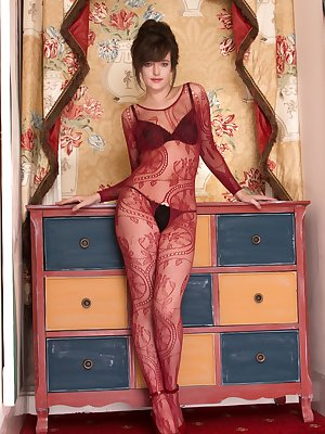Standing in her red body stocking and black lingerie, Kate Anne is awesome. She climbs on the counter and shows off her hairy pussy. She takes it off slowly and displays her beautiful all-natural body.