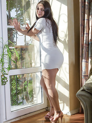Angelica Snow stands in her beautiful white dress which rides her so well. A slow and sexy striptease shows her white lingerie and then her all-natural body. We really enjoy when she spreads her legs too.
