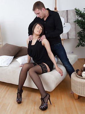 Savannah Secret is her black dress and stockings and is horny. She rubs her hairy pussy and her man starts licking and fucking it quickly. They both enjoy each other intensely until he cums on her pussy good.