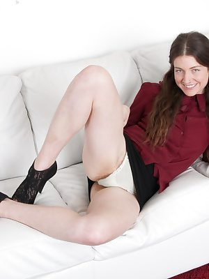 Mahonia is an American all-natural who is in her short black skirt and red top. She shows her pussy under her skirt and then strips naked. She poses naked, spreading her legs to show off her hairy pussy.
