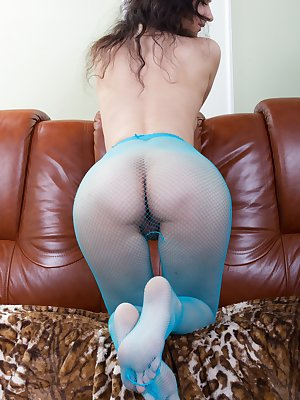 Wearing her favorite blue outfit, Ramira strips from her dress and blue stockings. She is incredibly busty and has a sexy hairy pussy. She masturbates on the sofa and her pink pussy wants more today.