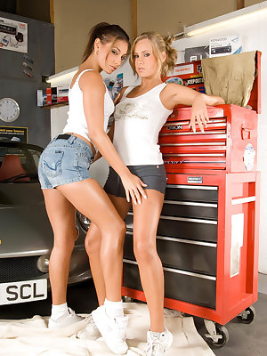 Lesbian couple at the car repair shop