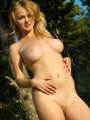 Hot blonde strips outdoors
