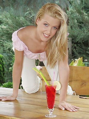 Stunning blonde poses on the table outside