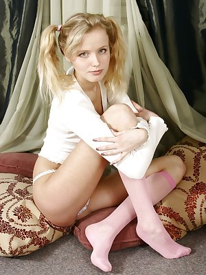 Cute little blonde with her pigtails gets naked for you