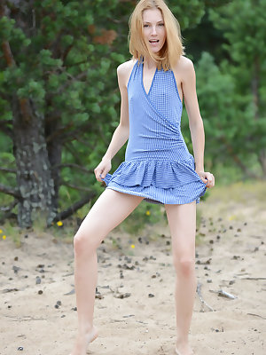 Nature calls her to drop that blue dress and show off some of her teen sexiness and those small tits she has hidden.