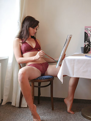 Tess Lyndon paints by the window as she sensually strips her sexy red lingerie.