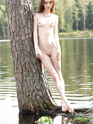 Newcomer Pala bares her petite body, small tits and tiny butt by the river.