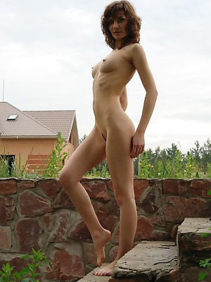 New model Jini sensually poses in the outdoors baring her creamy body with perky tits.