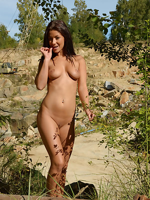 Gorgeous Tea Jul bares her delectable boddy with yummy pussy as she poses in the   outdoors.
