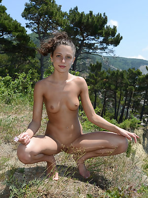 Katoa playfull poses in the outdoors flaunting her nubile body and yummy assets.