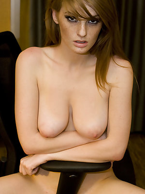 Faye Reagan bares her luscious body with large yummy tits and pink pussy on the chair.