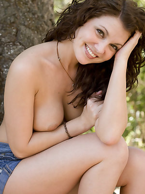 Stella definitely enjoys this outdoor shoot, flaunting her gorgeous, curvy body in front of the camera.