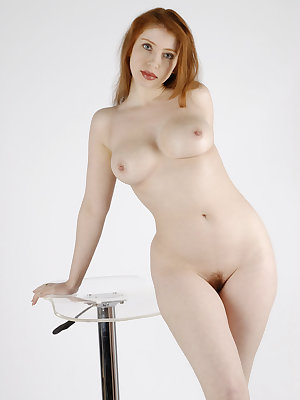 Against the plain white background, Alixia's voluptuous body stands out, with her perfectly erect nipples and cuppable breasts, shapely hips and thighs, meaty butt, as well as her enviable fair, porcelain smooth skin.