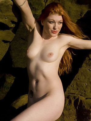 Ginger R displays her creamy, luscious body and sensually poses on the rocky seaside in   her debut series.