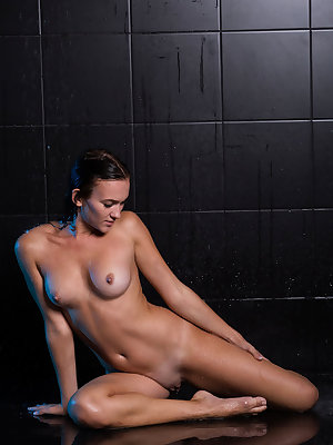 Indiana Black flaunts her wet, yummy body as she takes a shower.