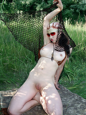 Playful and teasing Firebird A strips off her bikini, her porcelain complexion stands out against the verdant surrounding