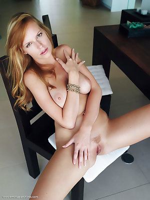 Natural redhead, Tubbea, looks lovely and natural while having fun posing in wide-open poses, displaying her lovely breasts and amazing pussy lips.