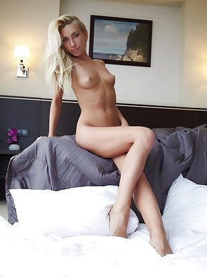Cute freckles, playfully blonde tousled hair, soft skin and a lickable pussy..Adele poses gracefully on a big comfy bed.