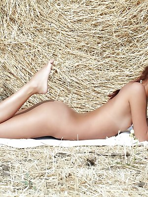 Afrodita looks comfortably seductive, sprawled wide open on a bedful of hay.