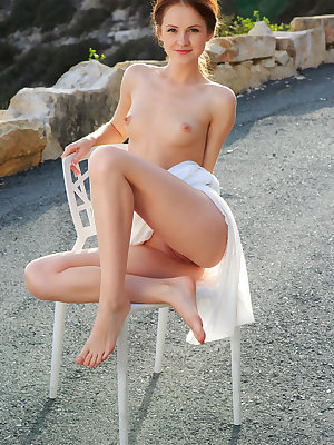 Alluring Alice May shows off her creamy body and pink pussy outdoors