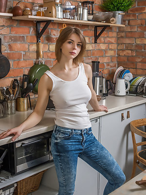 Busty Yelena serves her luscious body in the kitchen.