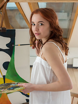 Redhead Erna flaunts her sweet, nubile body as she paints in her room.