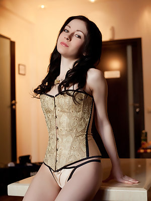 Effortlessly alluring Night A wearing a matching corset and thong panties, and knee-high stockings