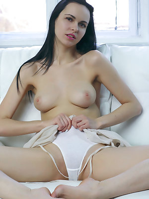 Nasita bares her gorgeous tits and smooth pussy as she strips on the sofa.