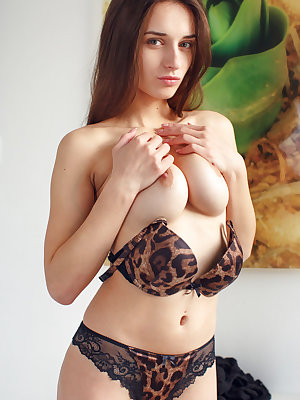 Gloria Sol sensually stripping off her matching lingerie to reveal her gorgeous breasts and shaved pussy