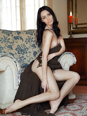 Zsanett Tormay shows off her sexy, tight body as she sensually poses on the sofa.