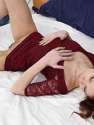 Emanuelle performs a titillating striptease in bed before showcasing her hairy pussy