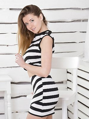Sybil A smile enticingly as she undresses her striped dress and starts touching herself