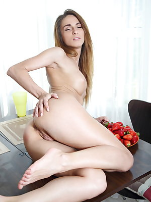 Cara Mell prepares a sumptuous feast of her ripe assets as she spreads her pussy lips on top of the dining table