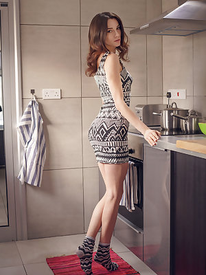 Adel Morel can't help herself getting naughty in the kitchen